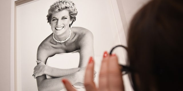 An image of Princess Diana taken by Patrick Demarchelier is inspected at the press preview for 'Vogue 100: A Century of Style' exhibiting the photographs that has been commissioned by British Vogue since it was founded in 1916 at National Portrait Gallery on February 10, 2016 in London, England.