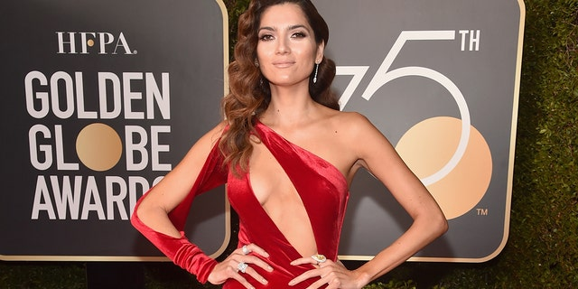 Blanca Blanco wears a red dress at the Golden Globes.