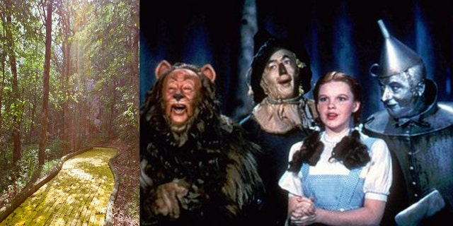 """FILE - In this 1939 file photo originally released by Warner Bros., from left, Bert Lahr as the Cowardly Lion, Ray Bolger as the Scarecrow, Judy Garland as Dorothy, and Jack Haley as the Tin Woodman, are shown in a scene from """"The Wizard of Oz.""""   (AP Photo/Warner Bros., file)"""