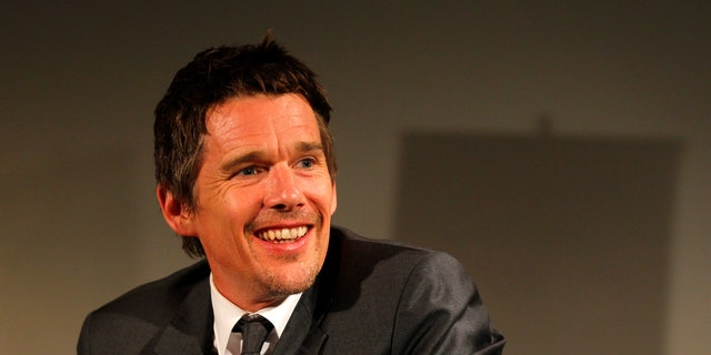 June 26, 2013. Ethan Hawke smiles during a news conference in Bucharest.