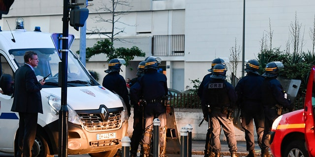 French riot police officers patrol in Nantes.