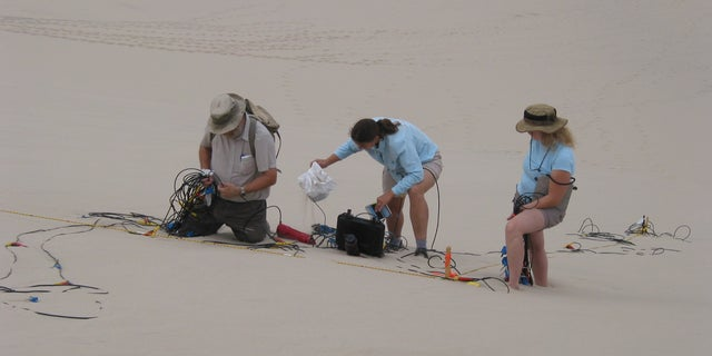 Set-up of geophone array on the Eureka Dune in Death Valley National Park, California.