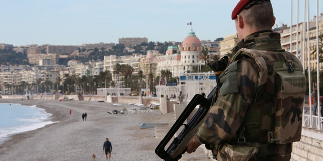 "A French soldier stands guard on the Promenade Des Anglais as part of the ""Vigipirate"" security plan in Nice, France, December 12, 2016."