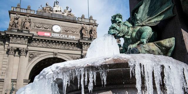 The icy Alfred Escher fountain is pictured in Zurich, Switzerland, Wednesday, Feb. 28, 2018.