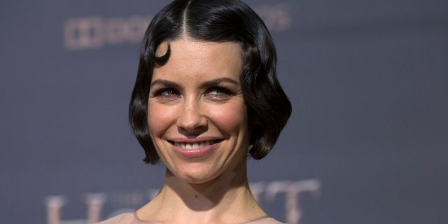 "Cast member Evangeline Lilly poses at the premiere of ""The Hobbit: The Battle of the Five Armies"" at Dolby theatre in Hollywood, California December 9, 2014."