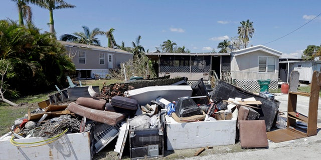 A pile of debris caused by a storm surge during Hurricane Irma, Sept. 18, 2017, in Everglades City, Fla.