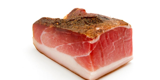 Speck (juniper-flavored ham originally from Tyrol) on a white background