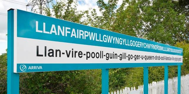 Station sign (on platform)Llanfair PGAngleseyNorthRailTransport
