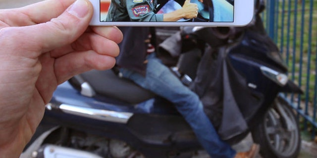 Is that Tom Cruise giving the thumbs up on a Harley?