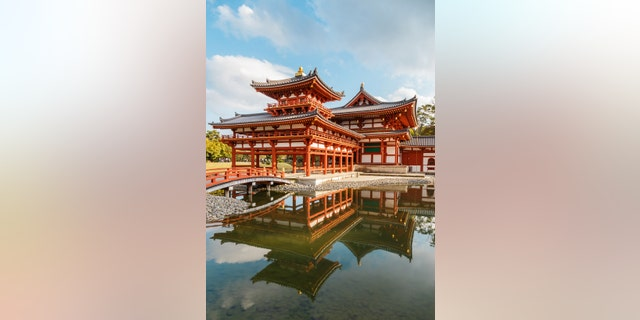 The Phoenix Hall of Byodo-in Temple in Kyoto, JapanKYOTO, JAPAN - OCTOBER 21: Byodoin Temple in Kyoto, Japan on October 21, 2014. Built in 998 AD during the Heian period, originally a private residence and converted into a temple by a member of the Fujiwara clan in 1052