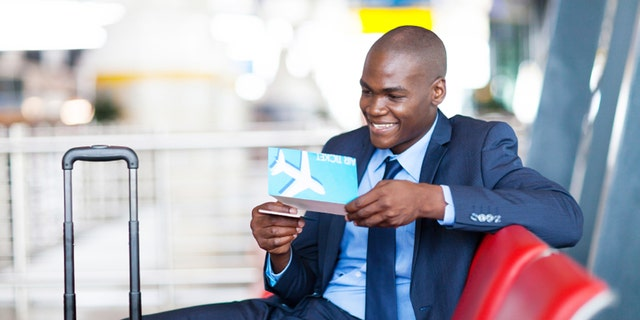 african businessman at airport waiting for flight