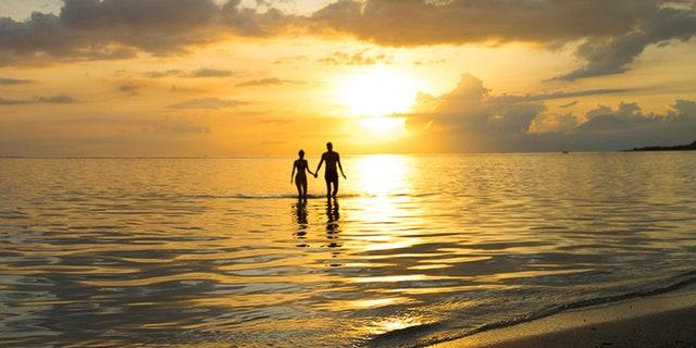 A serene sunset on the beach.
