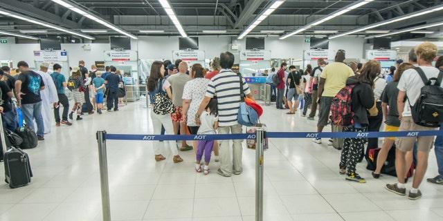 Bangkok,Thailand-August 31,2014 : Passengers departure  at passport control desk  in Suvarnabhumi Airport  in Bangkok ,Thailand.This airport is handling about 45 million passengers annually.