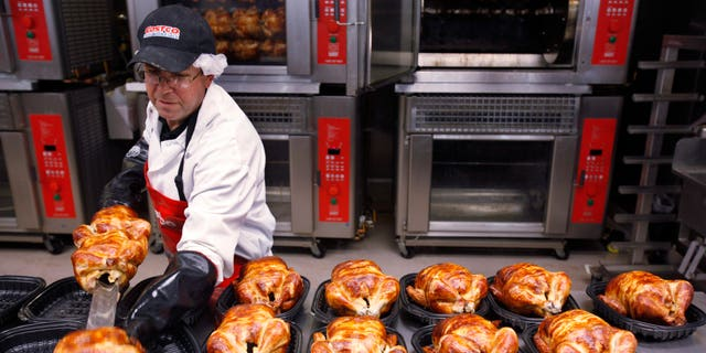 FILE - In this file photograph made March 3, 2010, a Costco employee cooks chicken at Costco in Mountain View, Calif. A private trade group says the service sector expanded in April, but at a slower pace than expected. (AP Photo/Paul Sakuma, file)