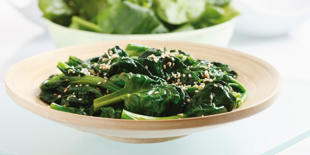 Blanched spinach leaves on plate