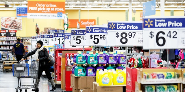 A customer pushes a shopping cart at a Walmart store in Chicago, Illinois, U.S. November 23, 2016. REUTERS/Kamil Krzaczynski - RTST0IQ