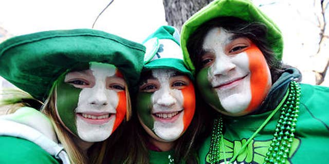 Annual St. Patrick's Day parade up Fifth Avenue in Manhattan  --   siblings LEFT TO RIGHT Jessica, Sabrina and John Burke get into the spirit   ---   {Tuesday in Manhattan 3-17-09}   Original Filename: DSC_8473x.JPG