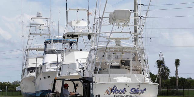 Super storm prep: A worker moves supports in place for boats that will be docked on land before Hurricane Matthew at Port Canaveral, Wednesday, Oct. 5, 2016, in Cape Canaveral, Fla.
