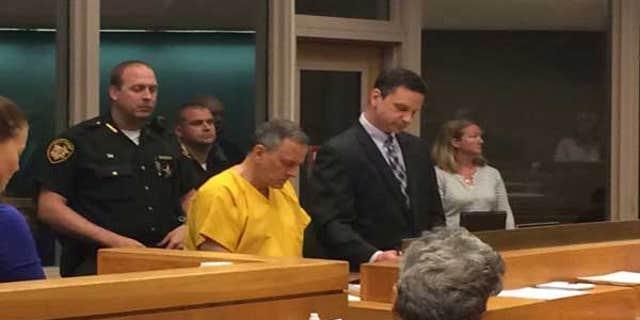 Jeffrey Hawkins seated in court.