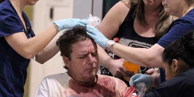 April 17, 2013: An unidentified man injured by the West fertilizer plant explosion is treated by nurses from Hillcrest Baptist Medical Hospital in Waco, Texas. (AP /Waco Tribune Herald)