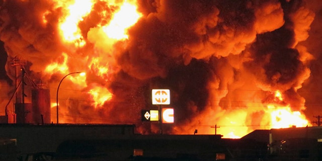 July 22: A fire burns at Red River Supply in an industrial part of Williston, N.D. The site is near three oil companies and a rail line, just east of Williston's downtown.