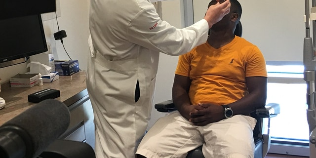 Rasaan Urquhart, 25, gets a checkup at Wills Eye Hospital in Philadelphia.
