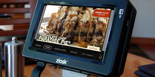 Chevys, Chili's, Applebee's and Uno Chicago Grill are trying the Ziosk, a device which lets diners order, pay, and play games at the table.