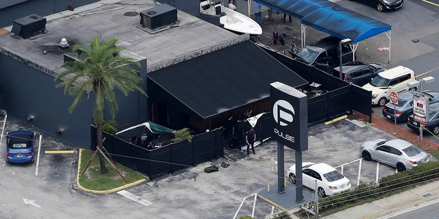 In this June 12, 2016, file photo, law enforcement officials work at the Pulse gay nightclub in Orlando, Fla., following a mass shooting.