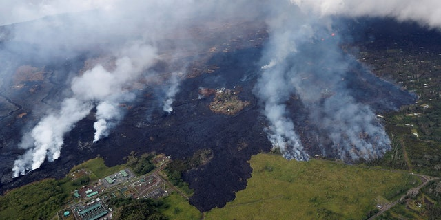 Lava approaches Puna Geothermal Venture, bottom left, in the Leilani Estates near Pahoa, Hawaii, U.S., May 28, 2018.