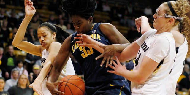 California center Talia Caldwell, center, pulls down a rebound as Colorado forwards Arielle Roberson, left, and Jen Reese cover in the second half of California's 53-49 victory in an NCAA college basketball game in Boulder, Colo., Sunday, Jan. 6, 2013. (AP Photo/David Zalubowski)