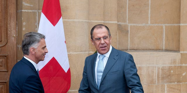 Russian Foreign Minister Sergei Lavrov, right, is welcomed by Switzerland's Federal Councillor and Foreign Minister Didier Burkhalter, left, for a working visit a Neuchatel, Switzerland, Friday, April 12, 2013. (AP Photo/Keystone/Sandro Campardo)