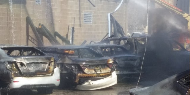 About 30 vehicles were damaged or destroyed in Wednesday's fire, officials said.
