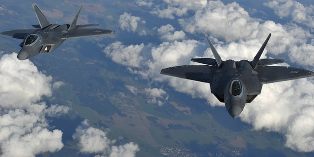 Two U.S. F-22 Raptor fighters fly over European airspace during a flight to Britain from Mihail Kogalniceanu air base in Romania April 25, 2016.