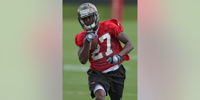 Tampa Bay Buccaneers cornerback Johnthan Banks runs with the ball during NFL football rookie minicamp Friday, May 3, 2013, in Tampa, Fla. Banks, from Mississippi State, was the Buccaneers second round pick. (AP Photo/Chris O'Meara)