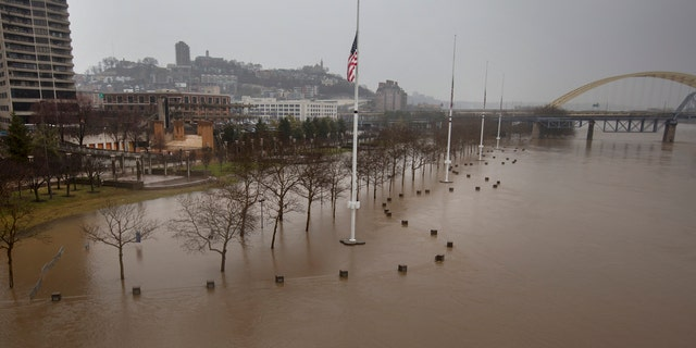 A view from the Central Bridge shows the flooding from the Ohio River Saturday, Feb. 24, 2018 in Cincinnati.