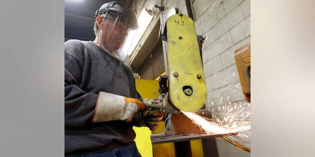 In this photo made on Thursday, Feb. 12, 2015, a workers grinds parts used to build fans for industrial ventilation systems at the Robinson Fans Inc. plant in Harmony, Pa. The Institute for Supply Management, a trade group of purchasing managers, issues its index of manufacturing activity for April on Friday, May 1, 2015. (AP Photo/Keith Srakocic)
