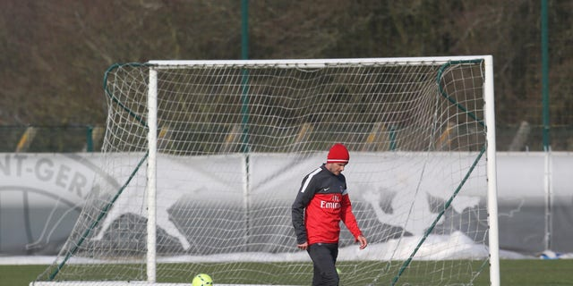 David Beckham is seen during a practice session with Paris Saint-Germain soccer team in Saint-Germain-en-Laye, west of Paris, Wednesday, Feb. 13, 2013. David Beckham started his first practice session with Paris Saint-Germain on Wednesday amid a media frenzy as dozens of camera crews and photographers jostled for position at the club's training ground in the western suburbs of Paris. (AP Photo/Michel Euler)