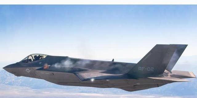 A pilot fires an F-35A's machine gun midflight during a test.