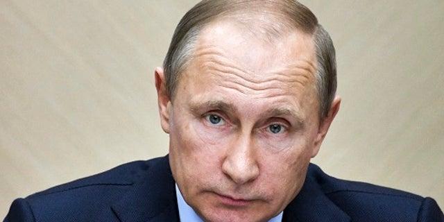 Russian President Vladimir Putin leads a cabinet meeting at the Novo-Ogaryovo residence outside Moscow, Russia, Wednesday, July 19, 2017. (Alexei Nikolsky, Sputnik, Kremlin Pool Photo via AP)