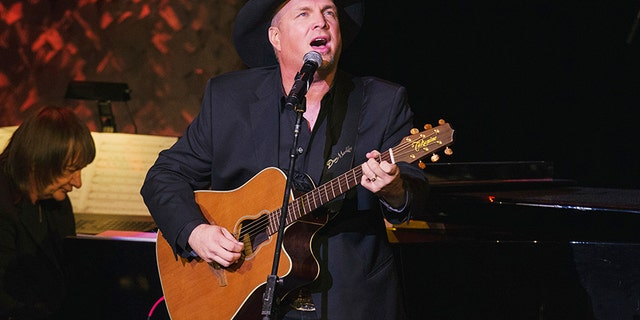 Nov. 17, 2014: Singer and songwriter Garth Brooks performs after accepting an award at the American Society of Composers, Authors and Publishers Centennial Awards in New York.