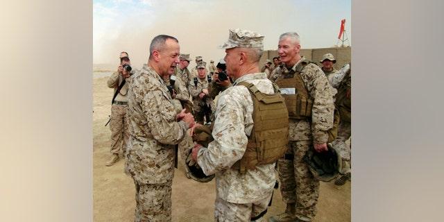Nov. 23, 2011: Marine Gen. John Allen, left, the top U.S. and NATO commander in Afghanistan, Gen. James Amos, commandant of the Marine Corps, and Marine Maj. Gen. John Toolan, right, the senior U.S. commander in Helmand Province, confer at Combat Outpost Alcatraz.