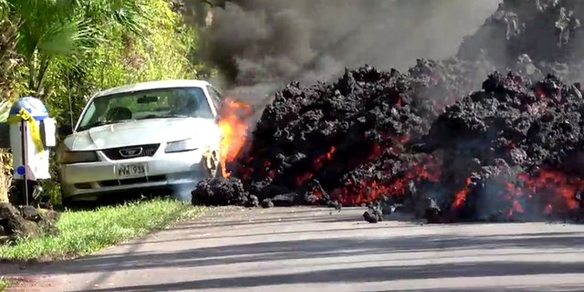 Lava engulfs a Ford Mustang in Puna, Hawaii, U.S., May 6, 2018 in this still image obtained from social media video.