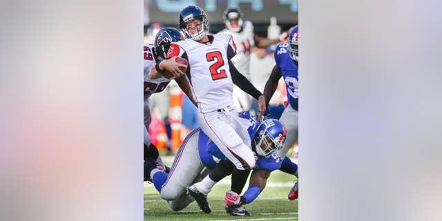 New York Giants defensive tackle Johnathan Hankins (95) sacks Atlanta Falcons quarterback Matt Ryan (2) during the second half of an NFL football game, Sunday, Oct. 5, 2014, in East Rutherford, N.J. (AP Photo/Kathy Willens)