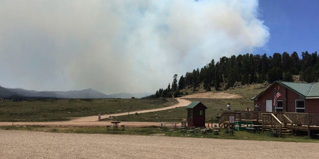 This photo provided by the National Park Service ranger Rachel Post shows a smoke plume from a wildfire in the Valles Caldera National Preserve, north of Jemez Springs, N.M., Thursday, June 15, 2017. The wildfire burning in northern New Mexico prompted the evacuation Thursday of residents and led the governor to activate the state emergency operations center. (Rachel Post/NPS via AP)