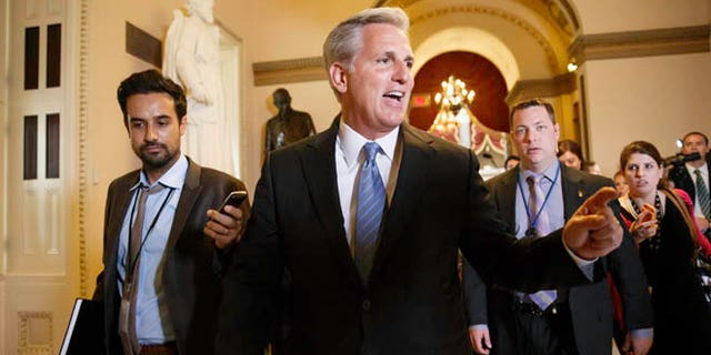 In this photo taken June 11, 2014, House Majority Whip, Republican Kevin McCarthy of Calif., leaves House Speaker John Boehner's office on Capitol Hill in Washington.  Emboldened conservatives are promising to make themselves heard on Capitol Hill like never before in the wake of Majority Leader Eric Cantor's surprise defeat to an unknown with tea party backing. That sets up the potential for struggles over Congress' most basic legislative responsibilities and dooms whatever slim hopes remained for ambitious bills on immigration or voting rights.  (AP Photo/J. Scott Applewhite)