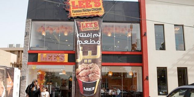 Thursday, Aug. 23, 2012:  Customers leave Lee's restaurant in Baghdad, Iraq.