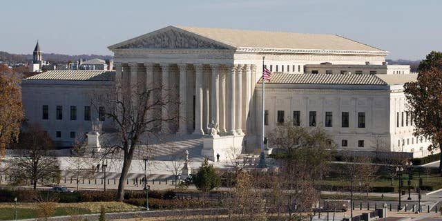 FILE - This Nov. 18, 2014, file photo shows the U.S. Supreme Court in Washington, as seen from the roof of the U.S. Capitol. Anthony Elonis claimed he was just kidding when he posted a series of graphically violent rap lyrics on Facebook about killing his estranged wife, shooting up a kindergarten class and attacking an FBI agent. But his wife didn't see it that way. Neither did a federal jury. In a far-reaching case that probes the limits of free speech over the Internet, the Supreme Court on Monday is considering whether Elonis' Facebook posts, and others like it, deserve protection under the First Amendment. (AP Photo/Carolyn Kaster, File)
