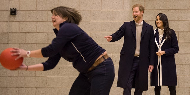 Britain's Prince Harry and his fiancee Meghan Markle watch Coach Core apprentices taking part in a training masterclass exercise during their to visit the Nechells Wellbeing Center in Birmingham, England, on March 8, 2018.