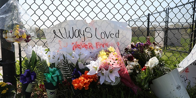 A makeshift memorial stands outside a park, where bodies of four men were found on April 13, in Central Islip, New York, U.S., April 28