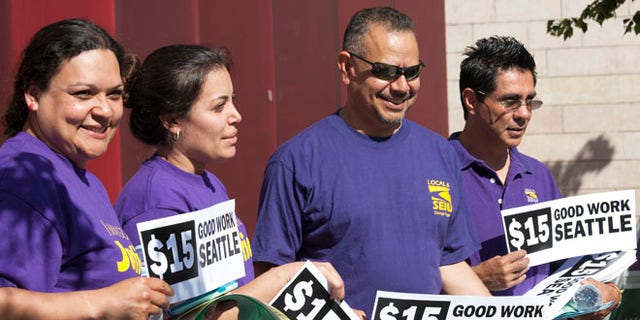 FILE: June 2, 2014: Labor activists at minimum-wage rally at City Hall, Seattle, Washington.